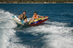 Band rafting. Two boys band-rafting in the Mediterranean Royalty Free Stock Images