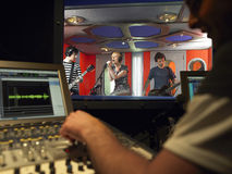 Band In Recording Studio. With technician in foreground Royalty Free Stock Photo