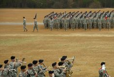 Band in Review. Army Marching Band passing in front of reviewing stand stock image