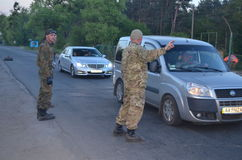 Band of rioters on improvised checkpoint check and marauding transport.Kiev Royalty Free Stock Image