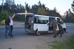 Band of rioters on improvised checkpoint check and marauding transport.Kiev Stock Photo