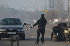 Band of rioters on improvised checkpoint check and marauding transport.Kiev Stock Image