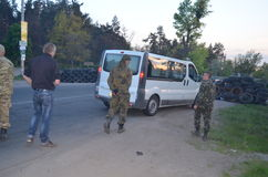 Band of rioters on improvised checkpoint check and marauding transport.Kiev Royalty Free Stock Photography