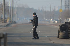 Band of rioters on improvised checkpoint check and marauding transport.Kiev Stock Photography