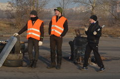 Band of rioters on improvised checkpoint check and marauding transport.Kiev Stock Images