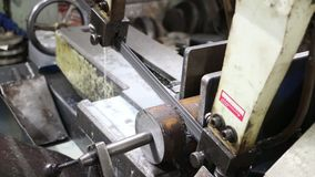 Electric saw on iron. Band saw cuts steel bar stock footage