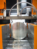 Band saw cutting steel bar Royalty Free Stock Images