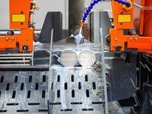 Band saw cutting steel bar Royalty Free Stock Image
