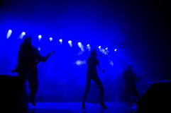Band on stage at concert. Band performing songs on stage Royalty Free Stock Images
