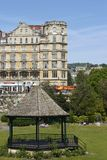 Band Stand. In Parade Gardens in Bath, Somerset, England. Empire Hotel in the background Royalty Free Stock Photos