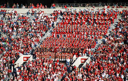 Band in the Stands. Alabama's Million Dollar Band sitting in the stand cheering on the Crimson Tide football team Stock Photos
