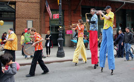 Band on stilts. Street band marching on stilts in the Royalty Free Stock Photography