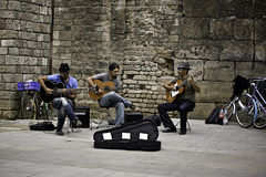 Band street in Barcelona, Spain. Street performers perform for people stock photos