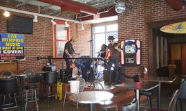 A Band Trio Performs Live Music on Beale Street. Royalty Free Stock Photo