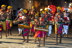 A band of young musicians perform along the streets of Kandy during the Esala Perahera. Royalty Free Stock Photography