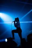 Banda adolescente del alboroto de Atari que realiza un concierto de rock Imagenes de archivo