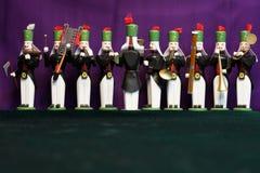 Banda de madera de los hombres con el fondo violeta Imagen de archivo libre de regalías