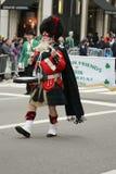 Banda del tubo dell'altopiano di Amityville che marcia alla parata del giorno di St Patrick a New York Fotografie Stock Libere da Diritti