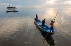Banda Islands, Indonesia - ca April 2014: Early morning a boat enters pulau Hatta. Stock Image