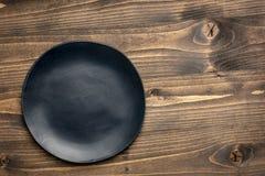 Banda nera su legno granuloso immagini stock libere da diritti