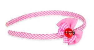 Banda rosada del pelo con el arco y la mariquita Imagenes de archivo