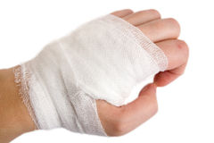 Bandage. The injured hand of the girl tied up by white bandage Stock Images