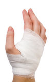 Bandage. The injured hand of the girl tied up by white bandage Royalty Free Stock Photography