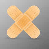 Bandage adhésif sur le fond gris. Photographie stock libre de droits