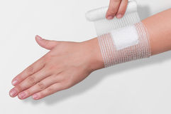 Bandage on the forearm  Royalty Free Stock Images
