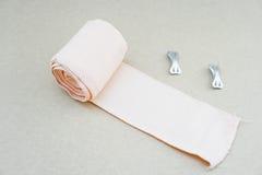Bandage and gauze roll with bandage strip Stock Photos