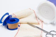 Bandage medical. Medical bandage scissors together, tape and cotton royalty free stock image