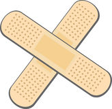 Bandage plaster. Two plaster bandages forming a cross Royalty Free Stock Photos