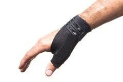 Bandage pour le pouce sur un man& x27 ; main de s - isolat Image libre de droits