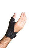 Bandage pour le pouce sur un man& x27 ; main de s - isolat Images stock