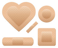 Bandage set. An adhesive bandage set including one in the shape of a heart Royalty Free Stock Images