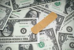 A bandage on the US economy. Concept of putting a bandage on the US economy royalty free stock photo