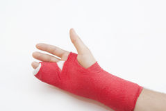Bandaged Arm With Broken Finger. Right hand bandaged in red plaster to support the healing process of broken bone. There is loads of copyspace as the backround Stock Photography