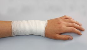 Bandaged arm of a child because of a lesion. Bandaged arm of a child because of a skin lesion stock photo