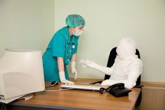 The bandaged boss and nurse Stock Photography
