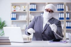 Bandaged businessman worker working in the office doing paperwor. K Stock Image