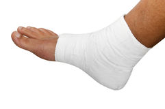 Bandaged foot. A bandaged foot on a white background stock photos