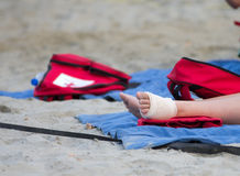Bandaged foot on the sand Royalty Free Stock Photo
