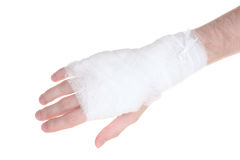 Bandaged hand. Over the white royalty free stock images