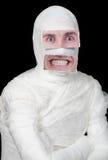 Bandaged man with false paper face Royalty Free Stock Photos