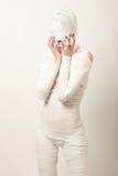 Bandaged mummy. Girl dressed as a bandaged mummy turns a blind eye Stock Images