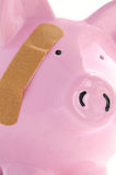 Bandaged piggy bank Stock Photo