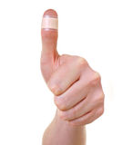 Bandaged thumb Royalty Free Stock Images