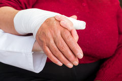 Bandaged thumb. Young doctor giving helping hand for the patient Stock Image