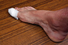 Bandaged toe Royalty Free Stock Images