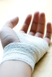 Bandaged wrist resting Stock Photo